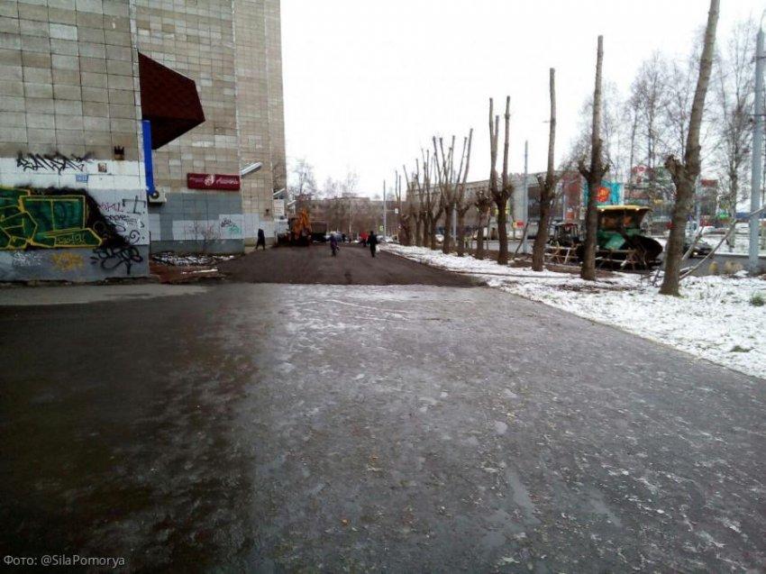 В Архангельск пришла зима, дорожные службы приступили к укладке асфальта