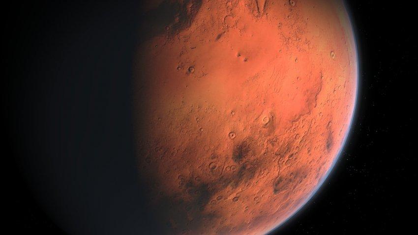 Опубликована фотография марсианского кратера, покрытого льдом